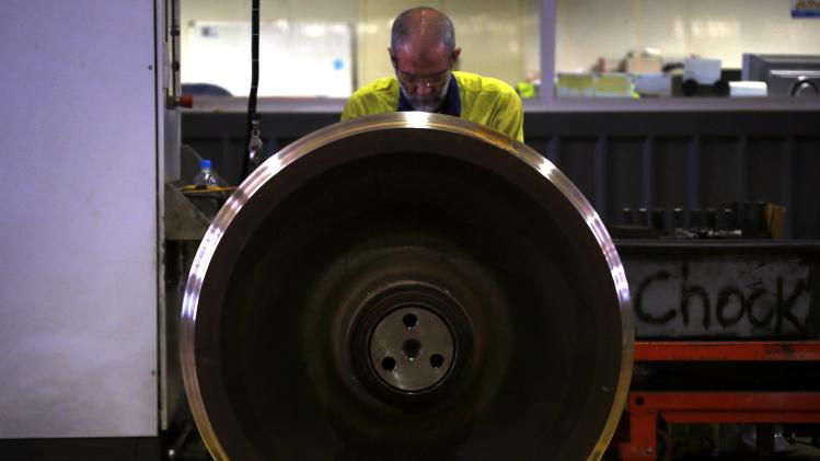 Worker checks the wheels of a train in the Fortescue train maintenance factory in Port Hedland