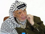 Palestinian leader Yasser Arafat at his headquarters in the West Bank town of Ramallah in January 2004. French prosecutors have opened a murder enquiry into Arafat's 2004 death near Paris, sources close to the matter told AFP Tuesday