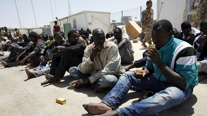 Illegal migrants who attempted to flee the coast to Europe are seen at the Libyan Navy base in the the coastal city of Tripoli
