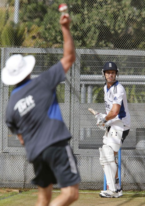 England's Nick Compton receives a ball from batting coach Graeme Gooch while practising in the batting nets ahead of the final cricket test against New Zealand in Auckland