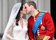 Prince William kisses his wife Catherine, Duchess of Cambridge, on the balcony in Buckingham Palace after their wedding service in April 2011. Their wedding was watched on television by up to two billion people around the world