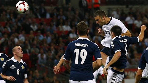 England's Rickie Lambert (2nd R) heads to score against Scotland (Reuters)