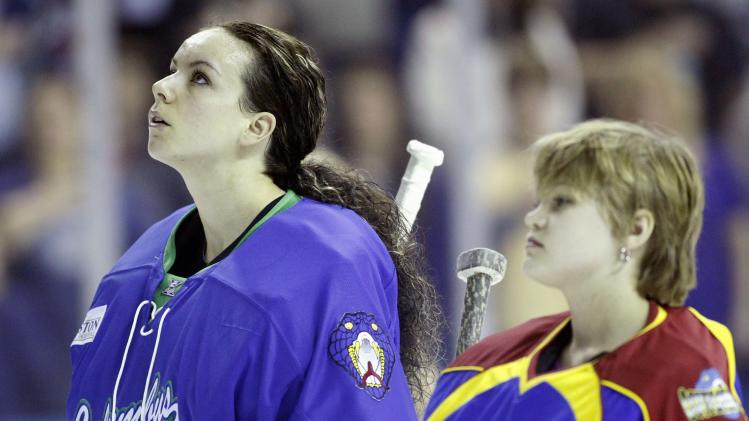 Columbus Cottonmouths goaltender Shannon Szabados of the Southern Professional Hockey League listens to the national anthem along with an honorary goalie prior to play against the Knoxville Ice Bears in Columbus