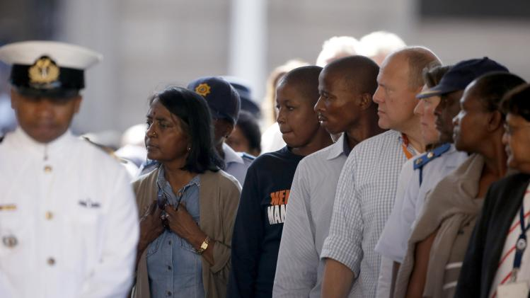 People pay their respects to former South African President Mandela in Pretoria