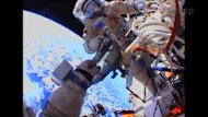 Russian cosmonauts perform a spacewalk to install photographic and scientific equipment on the hull of the International Space Station. Rough Cut (no reporter narration).