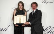 Actress Shailene Woodley, left, with her Chopard Trophy presented by actor Sean Penn during the Chopard Trophy awards ceremony at the 65th international film festival, in Cannes, southern France, Thursday, May 17, 2012. (AP Photo/Jonathan Short)