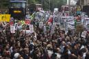 Protesters gather, while blocking the traffic, during a protest against Israel's air strikes in Gaza, in London