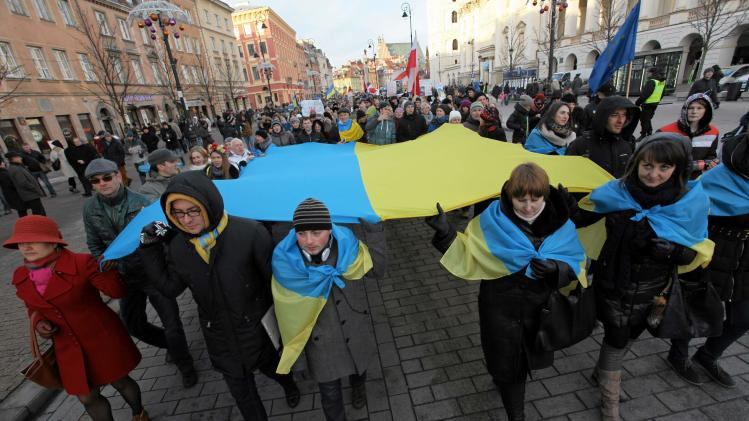 Demonstrators, consisting of mainly Ukrainian citizens living in Warsaw, take part in a march in Warsaw