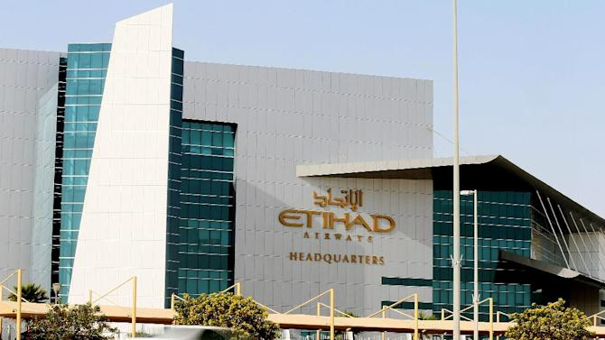 A car passes in front of headquaters of Etihad Airways in Abu Dhabi on March 13, 2014
