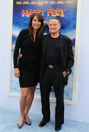 Robin Williams and his wife Susan Schneider at the …