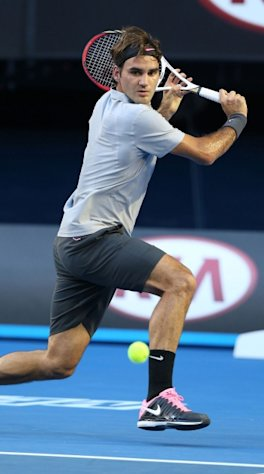 Roger Federer of Switzerland plays a backhand in his second round match against Nikolay Davydenko of Russia during day four of the 2013 Australian Open at Melbourne Park on January 17, 2013 in Melbourne