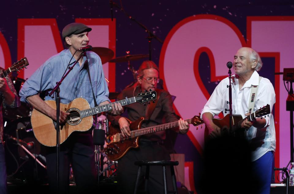James Taylor, left, and Jimmy Buffett perform at the Boston Strong Concert: An Evening of Support and Celebration at the TD Garden on Thursday, May 30, 2013 in Boston. (Photo by Bizuayehu Tesfaye/Invision/AP)
