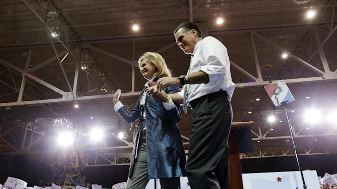 Ann Romney waves as she leaves the stage after introducing Republican presidential candidate and former Massachusetts Gov. Mitt Romney at a campaign rally at the International Exposition Center in Cleveland, Sunday, Nov. 4, 2012. (AP Photo/Charles Dharapak)
