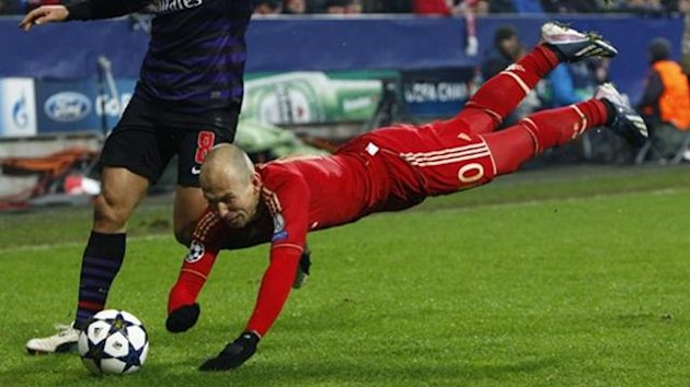Bayern Munich's Arjen Robben takes a tumble during a Champions League match against Arsenal (Reuters)
