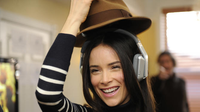 Actress Abigail Spencer wears Inspiration headphones by Monster Products at the Fender music lodge during the Sundance Film Festival on Friday, Jan. 18, 2013, in Park City, Utah. (Photo by Jack Dempsey/Invision for Fender/AP Images)