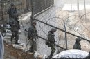 "South Korean Army soldiers patrol along a barbed-wire fence near the border village of Panmunjom in Paju, South Korea, Sunday, March 31, 2013. North Korea warned South Korea on Saturday that the Korean Peninsula had entered ""a state of war"" and threatened to shut down a border factory complex that's the last major symbol of inter-Korean cooperation. (AP Photo/Ahn Young-joon)"