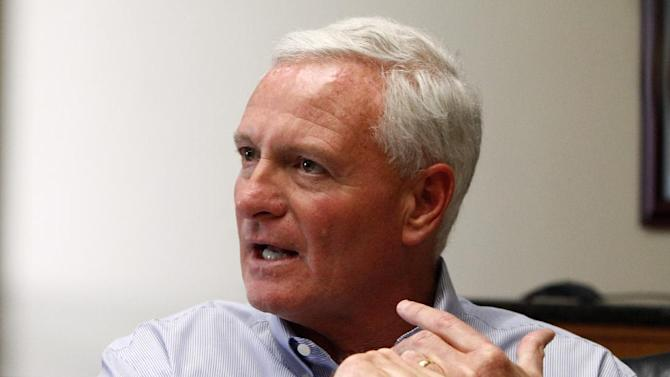 FILE -- This April 19, 2013, file photo shows Jimmy Haslam, CEO of Pilot Flying J, speaking during a press conference at the company headquarters in Knoxville, Tenn. A third employee of the truck stop chain owned by Jimmy Haslam, owner of the Cleveland Browns, and Tennessee Gov. Bill Haslam, pleaded guilty Tuesday, June 18, 2013, in what authorities call a scheme to cheat trucking firms out of rebates. (AP Photo/Wade Payne, File)