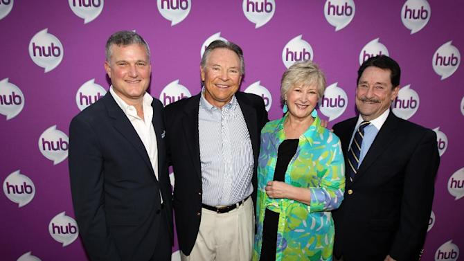 """IMAGE DISTRIBUTED FOR THE HUB - Stephen Davis, Hasbro Studios President, Frank Welker, actor and the voice of Megatron, Margaret Loesch, CEO & President of The Hub, and Peter Cullen, actor and the voice of Optimus Prime, from left to right, arrive at The Hub's """"Transformers Prime Beast Hunters"""" World Premiere Screening Event on Thursday, March 14, 2013 in Universal City, Calf. (Photo by Matt Sayles/Invision for The Hub/AP Images)"""