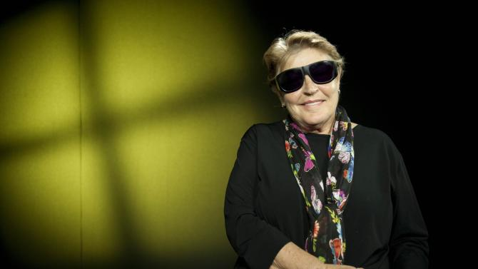 In this Monday, July 9, 2012 photo, Helen Reddy poses for a portrait after an interview at the in Los Angeles. Reddy recently had eye surgery and wished to keep her glasses on. The 70's pop singer is making her return to the musical stage this week, at a club in San Diego and for a high school benefit in Panorama City, outside of Los Angeles.  (AP Photo/Grant Hindsley)