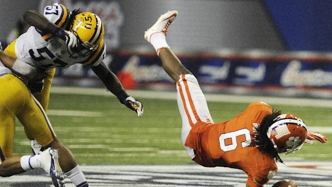Clemson wide receiver DeAndre Hopkins (6) makes a catch as LSU linebacker Lamin Barrow (57) defends during the second half of the Chick-fil-A Bowl NCAA college football game, Monday, Dec. 31, 2012, in Atlanta. Barrow was injured on the play. (AP Photo/Mike Stewart)