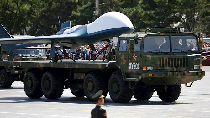 Military vehicles carrying unmanned aerial vehicles drive past the Tiananmen Square during the military parade marking the 70th anniversary of the end of World War Two, in Beijing