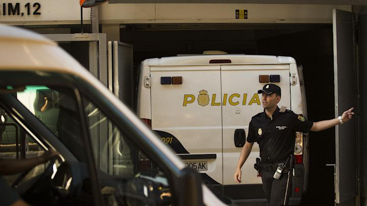 A police van, right, believed to be carrying Ashya King parents, parks inside the National court garage in Madrid, Spain Monday, Sept. 1, 2014. A critically-ill 5-year-old boy driven to Spain by his parents against doctors' advice is receiving medical treatment for a brain tumor in a Spanish hospital as his parents await extradition to Britain, police said Sunday. Officers received a phone call late Saturday from a hotel east of Malaga advising that a vehicle fitting the description circulated by police was on its premises. Both parents were arrested and the boy, Ashya King, was taken to a hospital, a Spanish police spokesman said. (AP Photo/Andres Kudacki)
