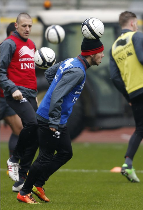 Belgium's soccer team player Hazard heads the ball during a training session in Brussels