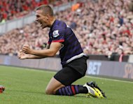 Summer signing Lukas Podolski admits Arsenal's style of play suits his game