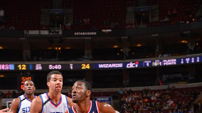 Wall leads Wizards over Sixers for first win