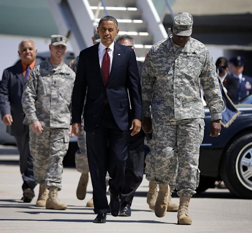 President Barack Obama walks with Gen. Lloyd Austin, vice chief of staff of the U.S. Army, right, to greet members of the military and their families on the tarmac, upon his arrival at Biggs Airfield at Fort Bliss, Texas, Friday, Aug. 31, 2012. (AP Photo/Pablo Martinez Monsivais)