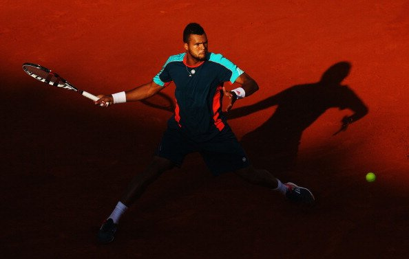 Jo-Wilfried Tsonga of France plays a forehand in his men's singles fourth round match against Stanislas Wawrinka of Switzerland during day 8 of the French Open at Roland Garros on June 3, 2012 in Pari