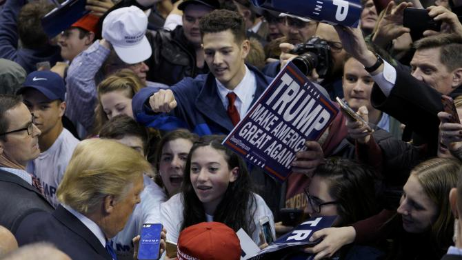 Republican U.S. presidential candidate Donald Trump signs autographs for supporters after speaking at the Verizon Wireless Arena during a campaign rally in Manchester