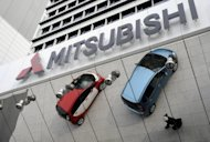 "The Mitsubishi Motors showroom at its headquarters in Tokyo. Mitsubishi Motors has ""temporarily"" halted shipments of its i-MiEV electric car to PSA Peugeot Citroen"