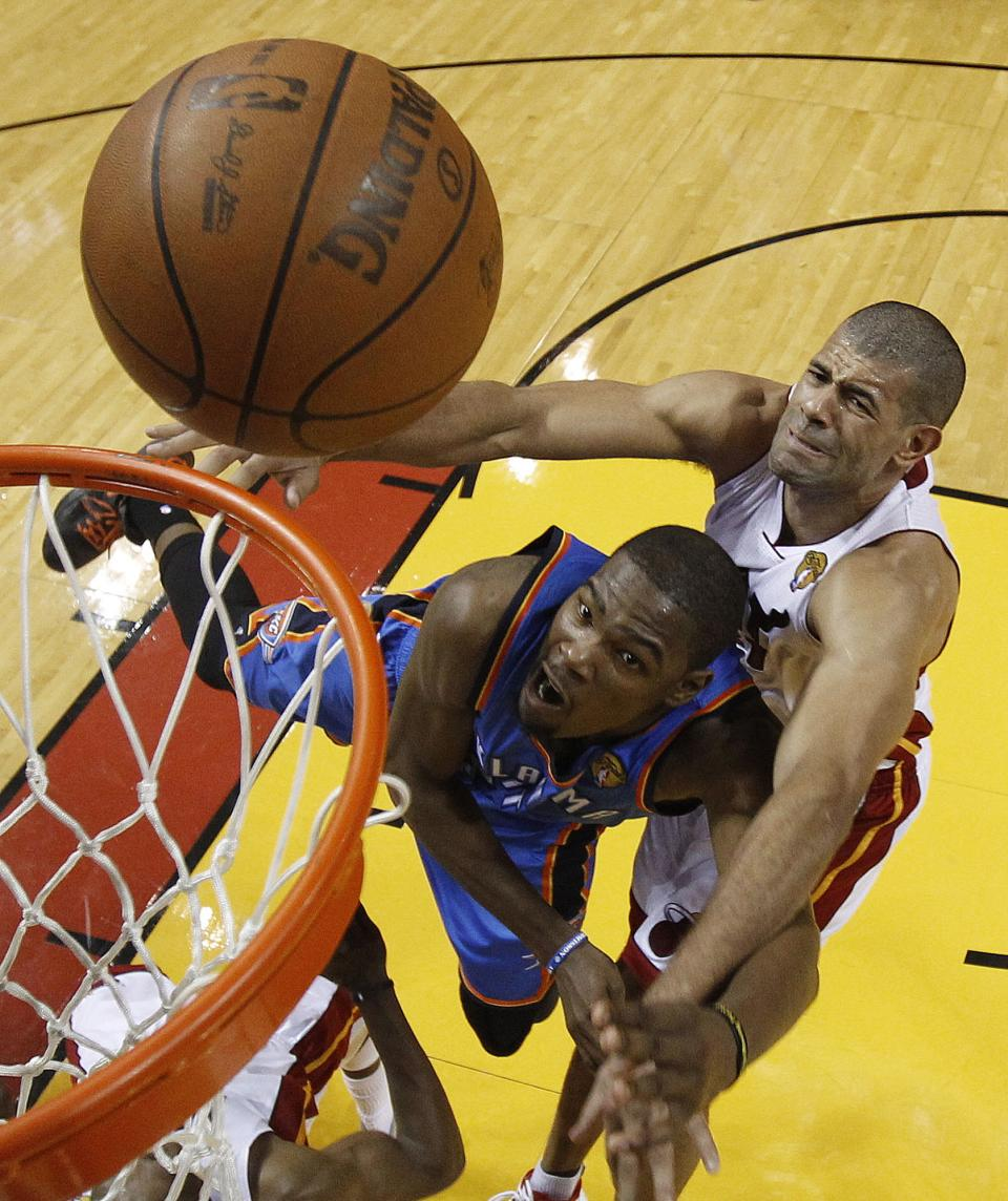 Oklahoma City Thunder small forward Kevin Durant (35) shoots against Miami Heat small forward Shane Battier (31) during the first half at Game 4 of the NBA Finals basketball series, Tuesday, June 19, 2012, in Miami.  (AP Photo/Mike Segar)