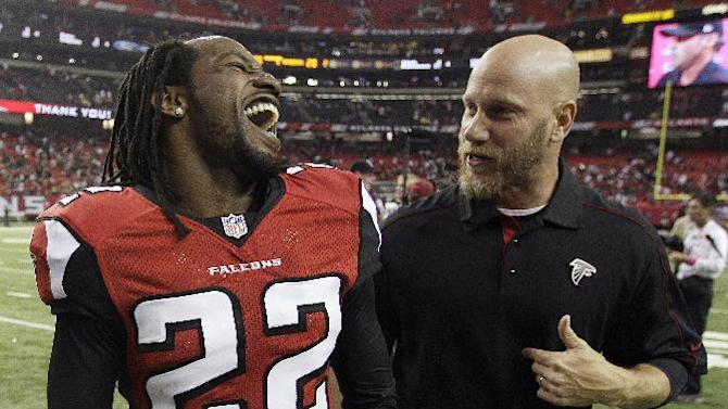 CORRECTS SCORE TO 23-20, NOT 26-23 - Atlanta Falcons cornerback Asante Samuel (22) speaks with Falcons director of athletic performance Jeff Fish after an NFL football game against the Oakland Raiders, Sunday, Oct. 14, 2012, in Atlanta. The Falcons won 23-20. (AP Photo/John Bazemore)