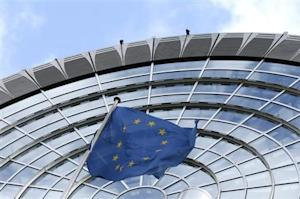 An European Union flag flutters outside of the European Parliament in Brussels