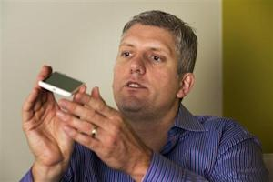Rick Osterloh, senior vice president of product management for Motorola Mobility, describes the size of Motorola's new Moto X phone at a launch event for the phone in New York