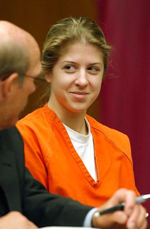 FILE - In this April 3, 2002 file photo, Sarah Dutra smiles while talking to her lawyer Kevin Clymo, left, before her arraignment in Stockton, Calif. Dutra, convicted of poisoning her boss in 2001, then stashing his body, is set to be released from prison on Aug. 26, 2011. (AP Photo/Michael McCollum, Pool)