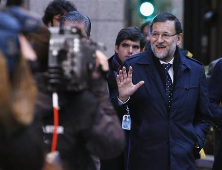 Spain's PM Rajoy arrives at European Union leaders summit at the EU council headquarters in Brussels