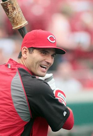 Cincinnati Reds' Joey Votto smiles during batting practice before an exhibition baseball against the Reds Futures minor league team, Tuesday, April. 3, 2012 in Cincinnati.  (AP Photo/Tony Tribble)