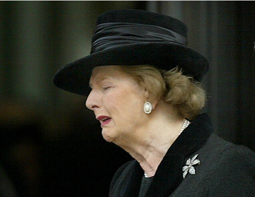 File photo of Margaret Thatcher reacting as she leaves a service of rememberance for her late husband Sir Denis Thatcher