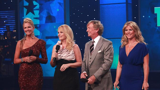 This photo provided by Muscular Dystrophy Association, The 46th annual Muscular Dystrophy Association telethon co-hosts,  from left to right, Nancy O'Dell, Jann Carl, Nigel Lythgoe and Alison Sweeney ad-lib personal salutes to Jerry Lewis, Sunday, Sept. 4, 2011, in Las Vegas. The hosts of the telethon say Jerry Lewis has retired from the yearly fundraiser, the organization's first comments since announcing the beloved icon's departure last month. (AP Photo/MDA, Richard Cartwright)