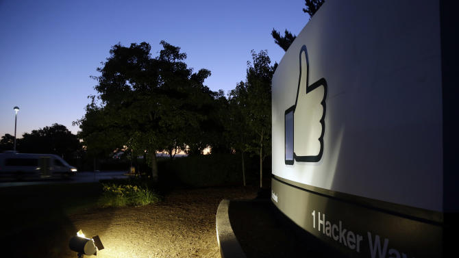 """The Facebook """"like"""" symbol is illuminated on a sign outside the company's headquarters in Menlo Park, Calif., Friday, June 7, 2013. A leaked document has laid bare the monumental scope of the government's surveillance of Americans' phone records — hundreds of millions of calls — in the first hard evidence of a massive data collection program aimed at combating terrorism under powers granted by Congress after the 9/11 attacks. The companies include Microsoft, Yahoo, Google, Facebook, PalTalk, AOL, Skype, YouTube and Apple.  (AP Photo/Marcio Jose Sanchez)"""