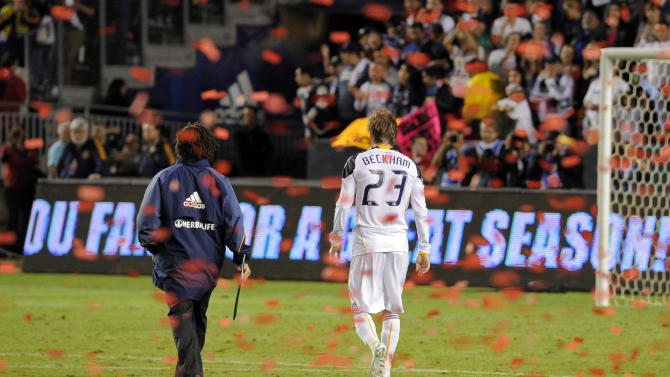 Los Angeles Galaxy midfielder David Beckham, right, and assistant coach Kobe Jones walk off the field after FC Dallas defeated them in their MLS Western Conference Final playoff match, Sunday, Nov. 14, 2010, in Carson, Calif. FC Dallas won 3-0. (AP Photo/Mark J. Terrill)