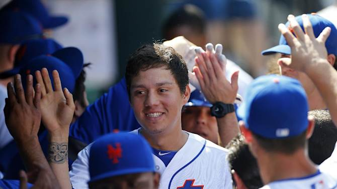 New York Mets' Wilmer Flores (4) is congratulated after scoring in the third inning against the Houston Astros during an inter-league baseball game Sunday, Sept. 28, 2014 at Citi Field in New York. The Mets defeated the Astros 8-3. (AP Photo/Rich Schultz)