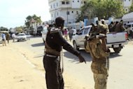 AMISOM (African Union Mission in Somalia) patrol the area of a bomb blast, claimed by Islamist rebels, that rocked a Mogadishu hotel where the newly elected Somali president Hassan Sheikh Mohamud was staying