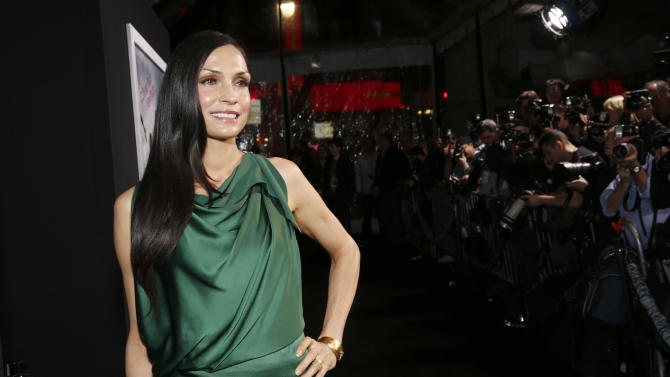 """Famke Janssen arrives at the premiere of """"Hansel & Gretel Witch Hunters"""" on Thursday Jan. 24, 2013, in Los Angeles.  (Photo by Todd Williamson/Invision/AP)"""