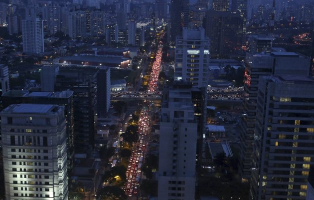 Vehicles move along a traffic jam during rush hour in Sao Paulo