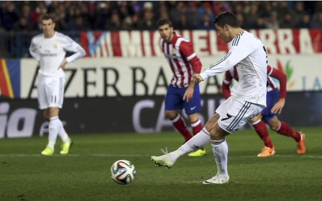 Real Madrid's Ronaldo scores a penalty against Atletico Madrid during their Spanish King's Cup semi-final second leg soccer match in Madrid
