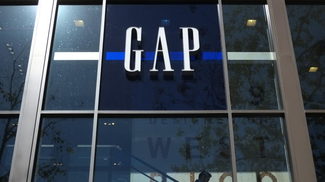 FILE - In this Tuesday, Feb. 26, 2013, file photo, a shopper walks down the steps at a Gap store in Los Angeles. Gap Inc. has announced plans to produce clothing in Myanmar, the first American retailer to enter the market since the country began its transition to democracy three years ago. (AP Photo/Jae C. Hong, File)
